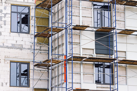 Building under construction with scaffolding