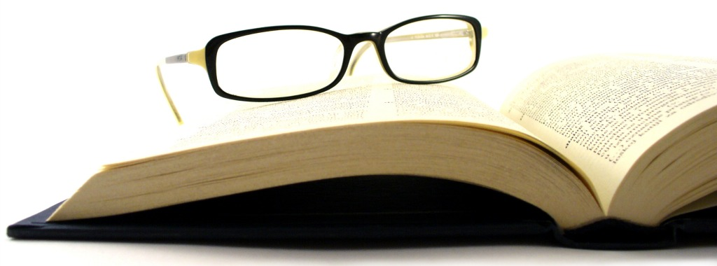 Dictionary book with women's glasses